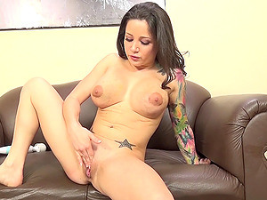 Buxomy dark-haired getting her face fucked after masturbating with a vibro