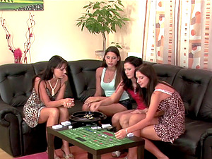 Four stunning girly-girl stunners have fun a board game before an orgy