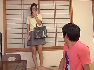 Charming Japanese chic awards her hubby's penis a superb handjob keeping it stiff