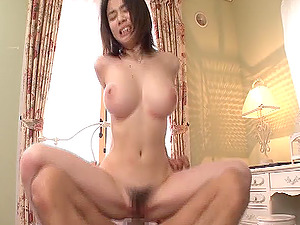 Big-boobed Asian chick with a hairy cootchie sucking a stranger's hard-on