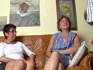 Mature German honies share a stiff fuckrod on the couch