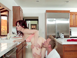 Hot plumber fixes the pipes of the sexy redheadhed chick
