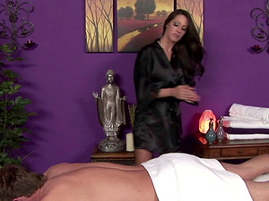 Sweetie August Ames gives a rubdown in sexy black satin