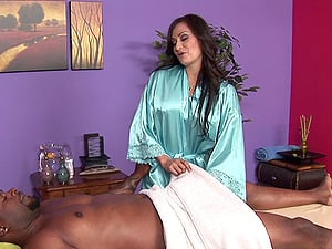 He picks the lovely brown-haired in a satin bathrobe to give a rubdown