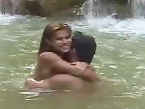 Shemale and a dude swim in a sea and do some hot fucking