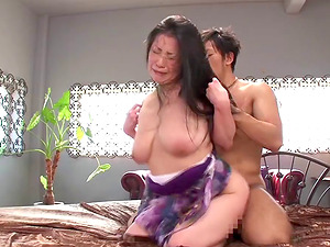 On her knees a sexy Asian Cougar takes it from behind