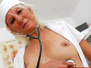 Nurse spreads her lengthy gams and puts a speculum in her cunt