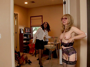 Stunning mature blonde in undergarments in a hot behind the scenes vid