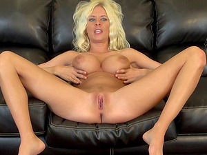 Stirring blonde just loves to get nasty on that soft couch!