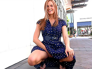 Beautiful woman in a flawless sundress for flashing in public