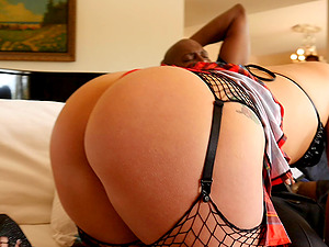 See this big jugs honey in fishnet ball gobbling after rough fucking with a black dude