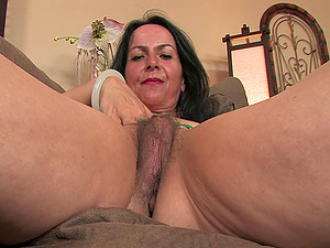Nina Swiss penetrates her own experienced vagina with a fucktoy