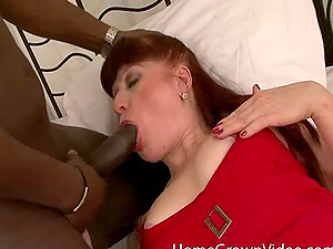 Cougar and a fat black penis get it on in her bedroom