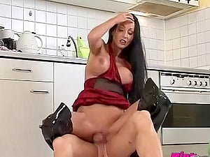 Shiny boots and sexy faux tits on a housewife getting a pounding