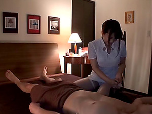 Masseuse from Japan provides the customer's penis with the jerking