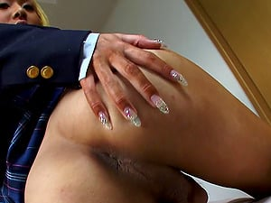 Man rod wanking Japanese tranny stunner in a pleated micro-skirt