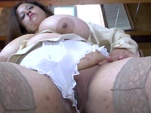 Fat chick in stockings shows her enormous breasts and masturbates the cunt