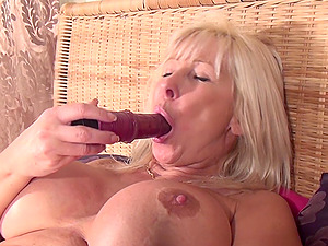 Blonde cougar with large tits uses the plaything to reach the ejaculation