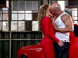 Skintight crimson spandex racing apparel on a smoking hot fuck tart