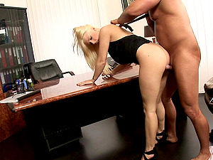 Nerdy blonde lies down on the table to be penetrated with passion