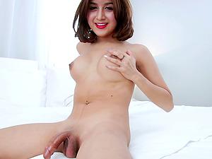 Asian tranny with a nice thick hard-on head masturbates off