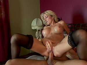 Cock-squeezing cougar with a supreme set of big faux tits fucks him