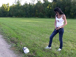 Skinny honey lies down on the grass and passionately masturbates snatch