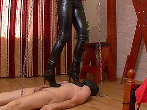 Skintight leather pants are stunning on a stomping mistress