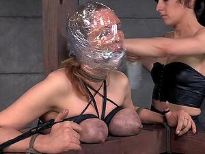Plastic packaged around the head of a super-cute restrain bondage bitch