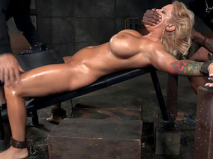 Blonde with big tits is a captive of two guys with big dicks