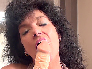 Nice matured granny drilling her cock-squeezing twat with gigantic plaything