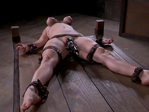 Senorita with tied up tits receives the stimulations in the dungeon space