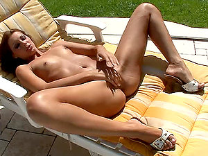 Pretty ginger-haired stunner masturbates after sunbathing