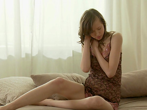 Skinny black-haired lady has a blast while masturbating gently