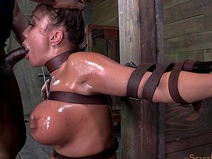 Oiled senorita with nice tits deepthroated with the massive black penis