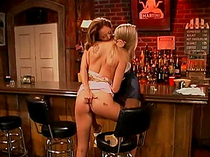 Two dirty-minded honies using the strap dildo fucktoy at the local bar