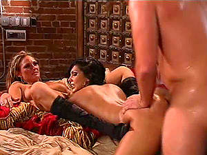 Two buxomy ladies having a threesome that's unlikely to leave behind