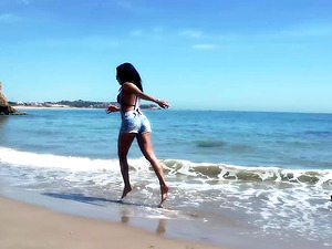 Slender Spanish Latina fucks herself on the beach