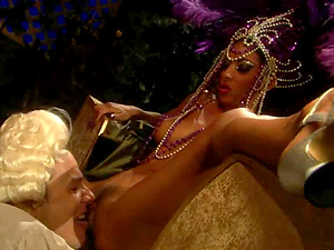 Stunner in a provocative exotic costume grabs and exploits a boner