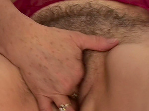 Elderly woman Petrina thumbs her hairy mature vulva