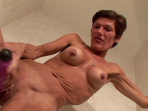 Mature skinny woman Florance plows her snatch with a fucktoy