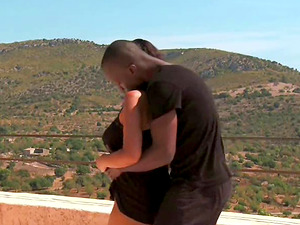Black fellow entices a hot petite brown-haired on a big balcony