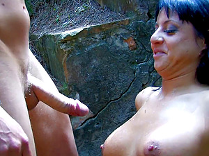 Brunette with amazing tits rides a guy's cock in a forest