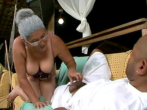 Granny Eva is curious about a black stallion's massive cock