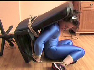 Naughty Amy tries to get out of a chair while being tied up