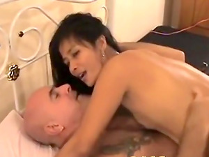 Vietnamese whore rides a white dong for cash