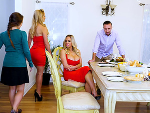 Cherie Deville hooks up with a blonde for a threesome in a kitchen
