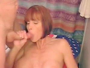MILF with melon tits takes cum in her mouth