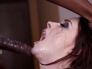 Chanel Preston having her throat cleaned with a black cum gun