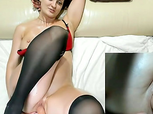 Cute woman  in stockings and sexy bra is being fucked by machine